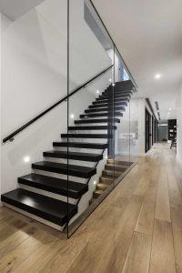 Designer glass staircase in the dark hues