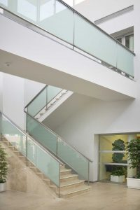 Modern staircase design with a walkway