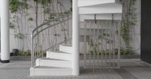 A spiral steel staircase in pristine white for outdoors