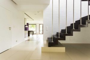 Warm and woody walnut staircase design