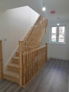 Oak staircase with contrasting spindles